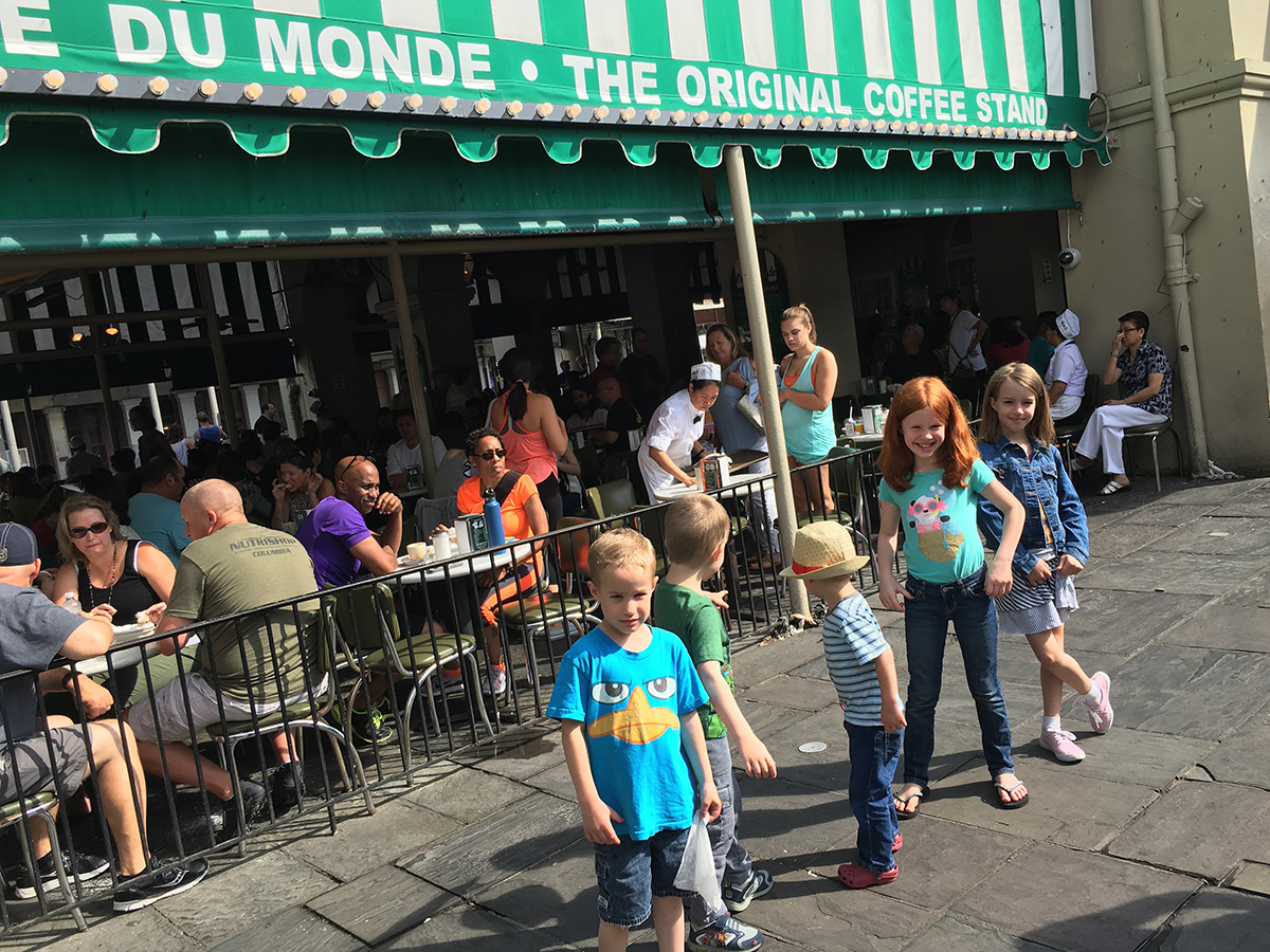 Cafe du Monde: the kids refusing to pose for a photo after we had the